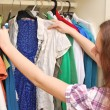 Happy young woman shopping for clothes at the mall  — Stock Photo