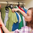 Happy young woman shopping for clothes at the mall — Stock Photo #13734259