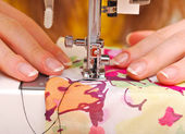 Hand sewing on a machine — 图库照片