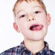 Little naughty boy portrait sticking out his tongue — Stock Photo #15391287