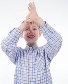 Portrait of an adorable young grimace boy — Stock Photo