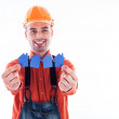 A builder man holding paper houses. — Stock Photo