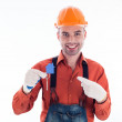 A builder man holding a key and a paper house. — Stock Photo