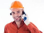Um construtor com fones de ouvido — Foto Stock