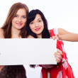 Two girls with banner. — Stock Photo