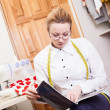 Dressmaker in a workroom — Stock Photo