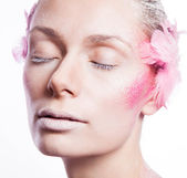 Blond fashion woman with pink face art — Stock Photo