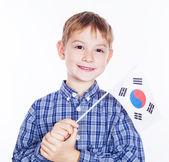 白い背景の上の南 koreanian フラグと小さな男の子 — ストック写真