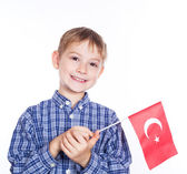 A little boy with turkish flag on the white background — Stock Photo