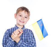 A little boy with ukrainian flag on the white background — Stock Photo