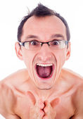 Humorous emotional portrait of grimacing young man — Stock Photo