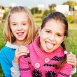 Little girls showing the tongue — Stock Photo