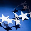 Paper stars group on a colour background — Stock Photo