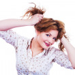 Portrait of a young woman holding her hair — Stock Photo