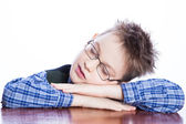 Sleeping boy on the table — Stock Photo