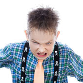 Agressive little boy shouts at the camera — Stock Photo