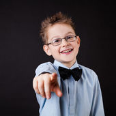 Little boy pointing out with a finger — Стоковое фото