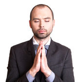 Businessman making a prayer. — Stock Photo