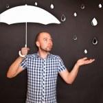 Man holding umbrella — Stock Photo #50738079