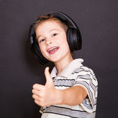 The young boy  listening to music — Stock Photo