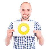 Man with gear sign — Stock Photo