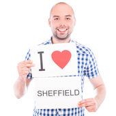 Man with city sign Sheffield. — Stock Photo