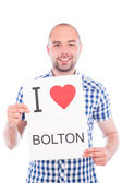Man with city sign Bolton. — Stock Photo
