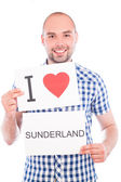 Man with city sign Sunderland. — Stock Photo