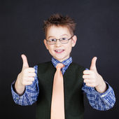 Cute boy showing thumbs up — Stock Photo