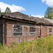 Old wooden house in russian village. — Stock Photo