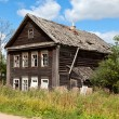 Old wooden house in russian village. — Stock Photo #12533628