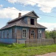 Old wooden house in russian village. — Stock Photo #12533634