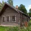 Old wooden house in russian village. — Stock Photo #12533660