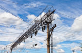 Forefront of a railway catenary with a blue sky — Stock Photo