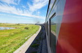 Train goes by rail in summer day, countryside. — Stock Photo