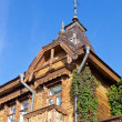 Stock Photo: Old wooden house over blue sky