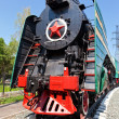 Old steam locomotive with red star — Stock Photo #13353658