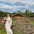 Young women on background of ancient traditional russian village — Stock Photo