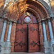 Stock Photo: Entrance in Roman-Catholic Church In Samara, Russia