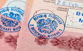 Visa entry and exit stamps in passport — Stock Photo