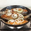 Fried fish in a frying pan — Stock Photo #15739971