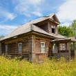 Old wooden house in russian village. Novgorod region, Russia. — Stock Photo #15790285