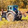 Stock Photo: Old tractor in field