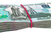 Russian rubles wrapped by rubber on white background — Stock Photo