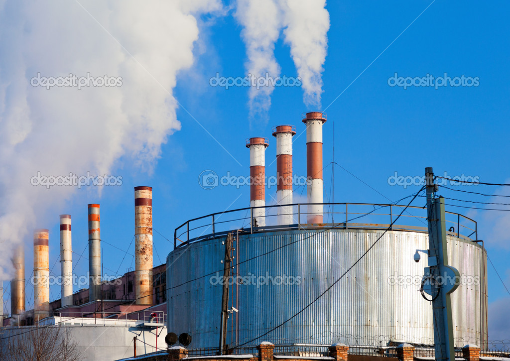 Lots of smoking chimneys other blue sky — Stock Photo #18276937