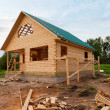 Wooden house under construction — Stock Photo #18648795