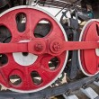 Stock Photo: Old steam locomotive wheel and rods details