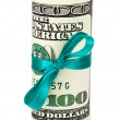 100 US dollar wrapped by ribbon over white background — Stock Photo