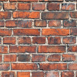 Old weathered red brick wall as background — Stock Photo #19013591