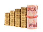 Russian rubles banknotes and coins over white — Stock Photo
